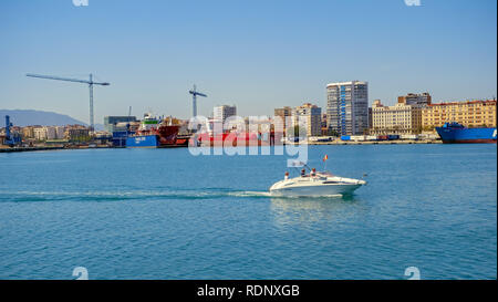 Malaga, Spain - April 17, 2018. A small yacht entering the port - Stock Photo