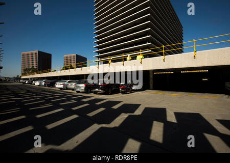 Shadow of Solar Arrays in parking lot of Los Angeles Department of Water and Power building, downtown Los Angeles, California, USA - Stock Photo