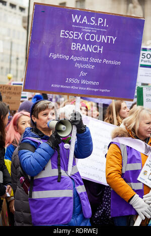 London, UK. - Jan 19, 2019: A WASPI campaigner during the Bread and Roses women's march through London. - Stock Photo