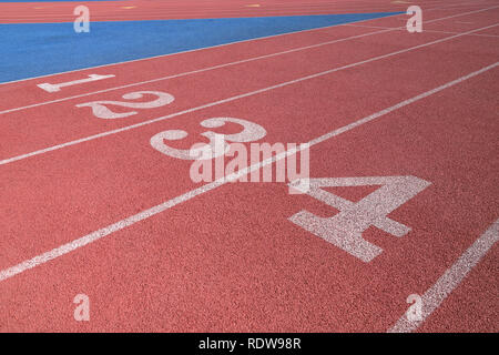 Track and Field race couse lane numbers - Stock Photo
