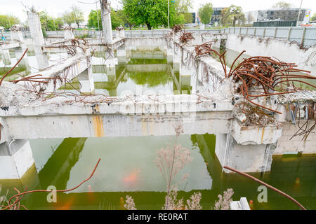 Deserted remains of commercial building foundations flooded left for reconstruction in Christchurch after the earthquake. - Stock Photo