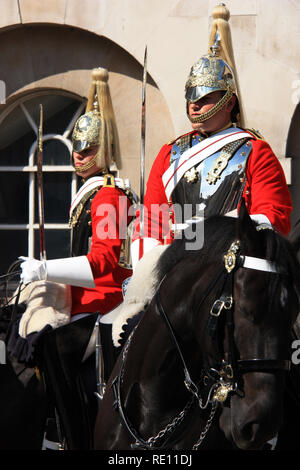 Royal Horse Guards on their horses during the Changing of the Guard in front of the Horse Guards historic building in London, United Kingdom - Stock Photo