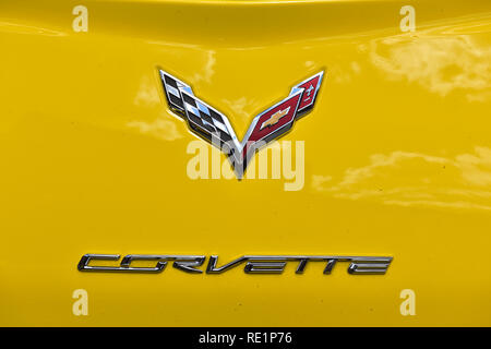 Chevrolet Corvette logo on yellow Corvette - Stock Photo
