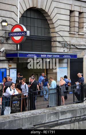 Bustling city life in front of the entrance of Baker Street Underground Station in London, United Kingdom - Stock Photo