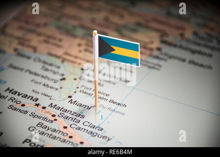 Bahamas marked with a flag on the map - Stock Photo
