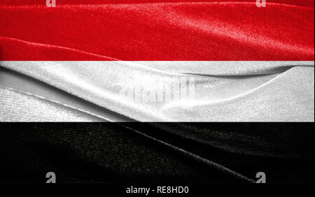 Realistic flag of Yemen on the wavy surface of fabric. Perfect for background or texture purposes. - Stock Photo