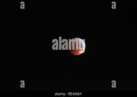 Gateshead. Newcastle upon Tyne. UK. 21st January, 2019. Total lunar eclipse - Blood Moon with Gateshead Millennium & Bridge Tyne Bridge. Quayside. Credit: David Whinham/Alamy Live News - Stock Photo