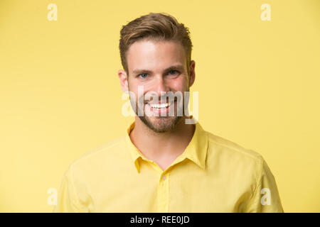 Brilliant smile. Man smiling face posing confidently yellow background. Man shop consultant looks cheerful confident and hospitable. Guy with bristle glad to help you in shop. Sincere emotions. - Stock Photo