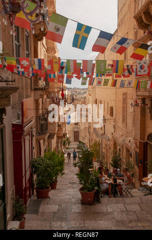 View down the steps of St. Lucia Street in Valletta, Malta with St. Lucia church at the end of it. - Stock Photo