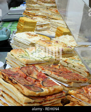 shop counter specialized in focaccia and stuffed pizzas in Italy - Stock Photo
