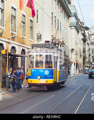 LISBON, PORTUGAL - OCTOBER 10, 2018: Tram at Lisbon Old Town street. Tram is the one of the landmarks in Lisbon - Stock Photo