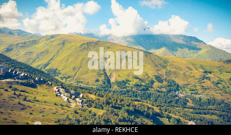 Saint Lary, France - August 20, 2018: Overview of the buildings of the Pla D Adet ski resort on a summer day - Stock Photo