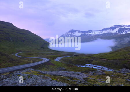 Sunset in the mountains on the way to the east fjords in Iceland - Stock Photo