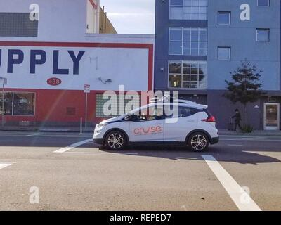 Side view of Cruise self driving car from General Motors with safety driver visible driving through downtown San Francisco, California, January 4, 2019. () - Stock Photo