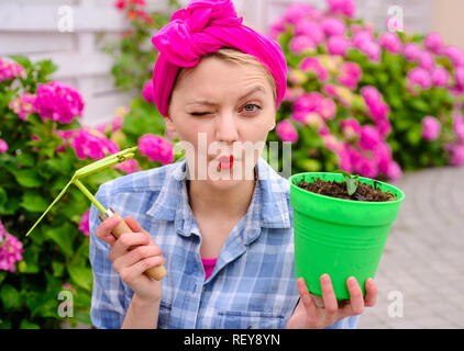 hydrangea. Spring summer. Flower care and watering. soils and fertilizers. Greenhouse flowers. woman care of flowers in garden. happy woman gardener with flowers. Positive florist holding flowerpot - Stock Photo