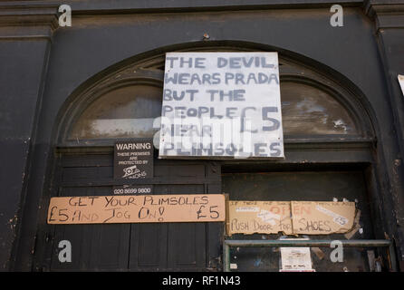 Humorous sign above Blackmans shoe shop in Cheshire Street in Spitalfields in London referring to the film 'The Devil Wears Prada' - Stock Photo