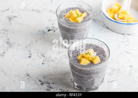 Mango chia pudding almond milk in glasses, healthy  breakfast meal, delicious dessert or snack - Stock Photo