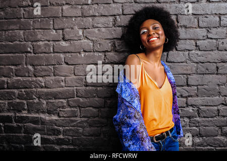 Adorable african american model in a trendy shirt posing for the photo - Stock Photo