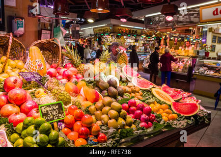 Fruits and vegetables are sold inside the Mercat de Sant Josep de la Boqueria, a public market with an entrance from La Rambla - Stock Photo