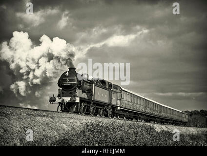 Ex GNR N2 class loco and a Gresley designed Quad-Art set of articulated suburban carriages recreate a commuter train from the mid-1920's. - Stock Photo