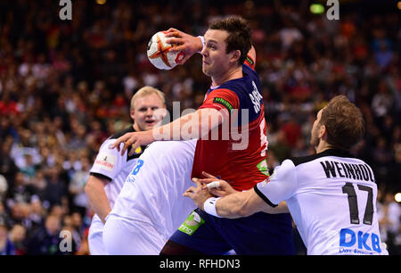Hamburg, Germany. 25th Jan, 2019. Norway's Sander Sagosen throws at the goal next to Germany's Steffen Weinhold. Credit: Soeren Stache/dpa/Alamy Live News - Stock Photo