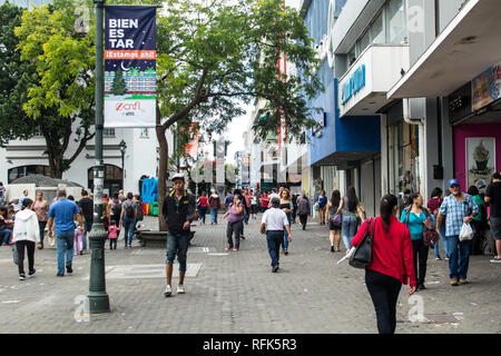 A photograph of a busy street crowded with people in downtown San Jose, capitol of Costa Rica - Stock Photo
