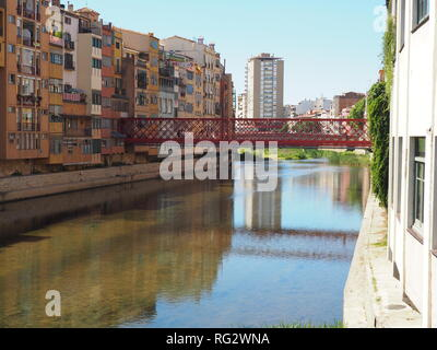 River Onyar with the Eiffel Bridge and block of houses in the background - Girona - Catalonia - Spain - Stock Photo
