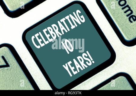 Writing note showing Celebrating 10 Years. Business photo showcasing Commemorating a special day Decennial anniversary Keyboard key Intention to creat - Stock Photo