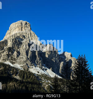 Sassongher peak seen from Corvara in Badia in the Dolomites, South Tyrol, Italy. Beautiful winter sunny day - Stock Photo