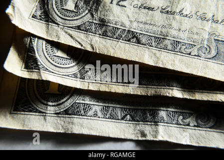 Dolar USA close-up. Old battered crumpled bills macro. The texture of the fragment of the dollar bill. USD banknote texture. - Stock Photo
