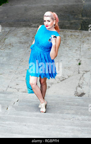 beautiful woman going up the steps, the theme of beautiful vibrant women - Stock Photo