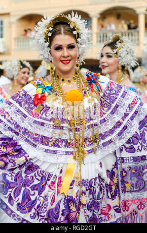 Woman wearing pollera, a traditional dress from Panama. There are many varieties of polleras, depending on its use and place of origin. - Stock Photo