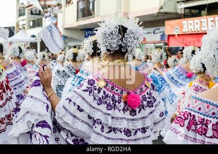 Women wearing Panamanian traditional clothes, known as 'pollera'. There are many varieties of polleras, depending on its use and place of origin. - Stock Photo