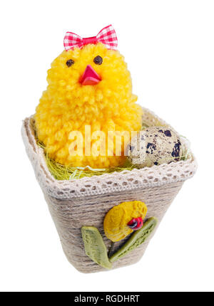 Easter handmade  nest from rope with funny chicken and egg. Isolated on white studio macro shot - Stock Photo