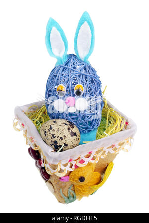 Easter handmade  nest from rope with funny bunny  and  quail egg. Isolated on white studio macro shot - Stock Photo