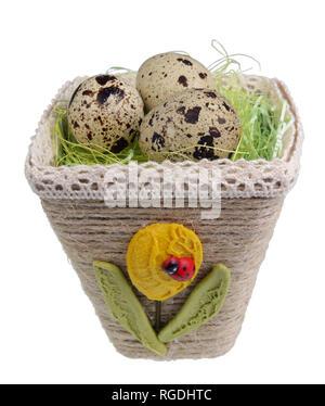 Easter handmade  nest from rope with  quail egg. Isolated on white studio macro shot - Stock Photo