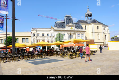 LE MANS, FRANCE - August 18, 2018: Old street and restaurants in city center of Le Mans. France. People relax in a cafe and walk along a Le Mans city  - Stock Photo