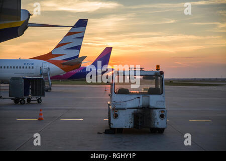 Katowice-Pyrzowice/Poland. Morning at the airport. Airport on the island of Crete in Greece. Unloading luggage at the airport. - Stock Photo