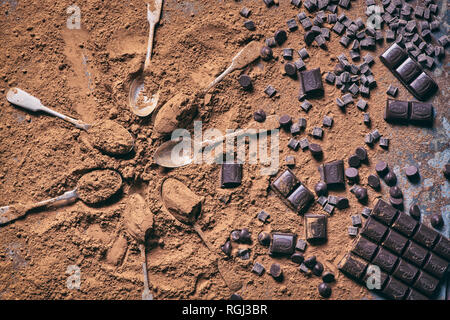 Old vintage teaspoons and chocolate pieces and cocoa powder - Stock Photo