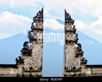 Historical Lempuyang temple landmark, Bali, Indonesia, Asia, with stunning view through gates on blue cloudy mountain top in the background. No one, q - Stock Photo