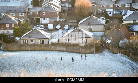 Brighton UK 30th January 2019 - Families play in the snow on the Whitehawk housing estate in Brighton today as more snow and freezing conditions are forecast for the south east of Britain tomorrow Credit: Simon Dack/Alamy Live News - Stock Photo