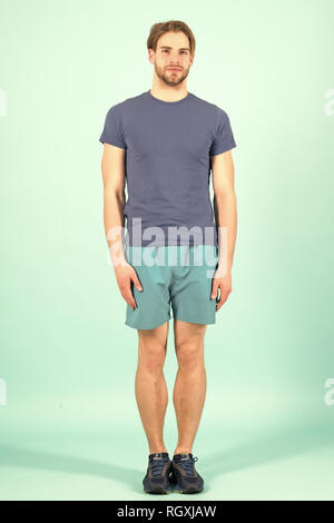 Sportsman stand arms at side. Fashion athlete in blue sport uniform. Bearded man with stylish hair. Sport fashion and style. - Stock Photo