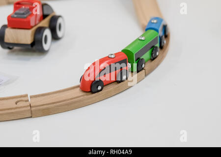 wooden train, build toy railroad at home or daycare. Wooden toy train with colorful blocs isolated on white background. Educational toys for preschool - Stock Photo