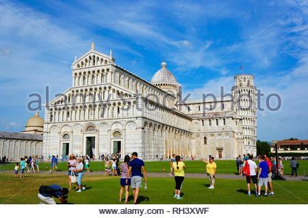 Pisa, Italy - August 21, 2014: People on green - Stock Photo