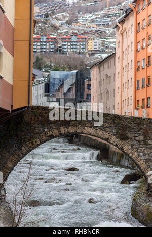 ESCALDES-ENGORDANY, ANDORRA - February 1: River Valira on Engordany Bridge and houses view in a snowfall day in small town Escaldes-Engordany in Andor - Stock Photo