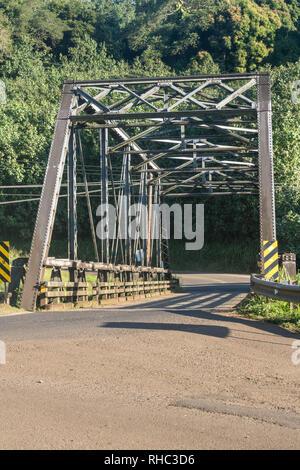 Old steel girder bridge on road to Hanalei in Kauai - Stock Photo