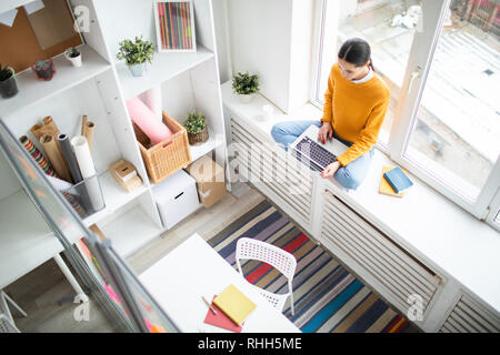 Woman searching in the net - Stock Photo