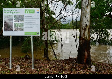 Landcare in Mundingburra sign, Queensland, Australia. 3 February 2019. Flooding continued to worsen as the deluge continued and more water was released from the bulging Ross River dam to prevent the failure of the dam wall. Credit: P&F Photography/Alamy Live News - Stock Photo