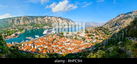 A panoramic view of the Bay of Kotor, cruise port, mountains and the medieval walled old town from the ruins of the Castle of San Giovanni - Stock Photo