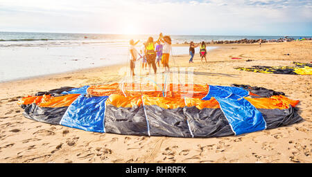 Mazatlan, Mexico-10 December, 2018: A group of diverse young men learning kite surfing in Golden Zone (Zona Dorada), a famous touristic beach and reso - Stock Photo